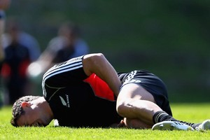 Dan Carter of the All Blacks shows the pain of a groin injury suffered during the Rugby World Cup 2011. Photo / Getty Images