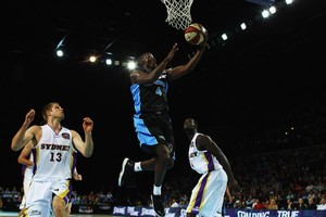 Cedric Jackson of the Breakers lays the ball up round three match between the New Zealand Breakers and the Sydney Kings at Vector Arena. Photo / Brett Phibbs