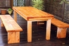 The finished macrocarpa table and bench seats. Photo / Janna Dixon