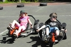 Rhiannon Osborne and Harry Ward try out special bikes at a Living Springs camp in Christchurch. Photo / Supplied