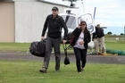 Chris Knight with his wife Kim who is 6-months pregnant. They are relieved to have been helicoptered out of Cable Bay. Photo / Tim Cuff
