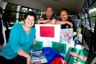 Hands of Hope members Rangi Carreira (left), Les Denton and Deidre Tai with Christmas care hampers for families in Mangere. Photo / Dean Purcell