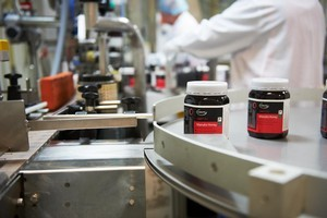 Honey being packaging on a conveyor belt by honey products maker Comvita. Photo / supplied