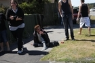 Quake terror... frightened residents of Chadbury St in the Christchurch suburb of Parklands react as yesterday's 6.0 magnitude quake strikes. Photo / Geoff Sloan