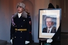 A guard of honor stands next to a portrait of former Czech President Vaclav Havel at the Prague Castle. Photo / AP