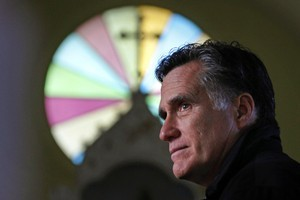 Mitt Romney is seen as being detached from the economic problems facing many Americans. Photo / AP
