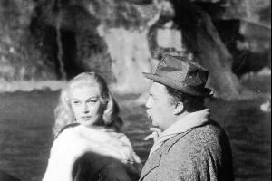 Federico Fellini advises Swedish actress Anita Ekberg during the filming of 'La Dolce Vita' in 1960. Photo / AP