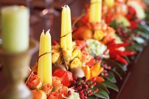 Sprucing up the dinner table with flower arrangements will put all in a cheerful, festive mood. Photo / New Zealand Herald