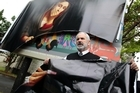 Arthur Skinner in front of the controversial St-Matthew-in-the-City billboard of the Virgin Mary holding a pregnancy test that he vandalised. Photo / Richard Robinson
