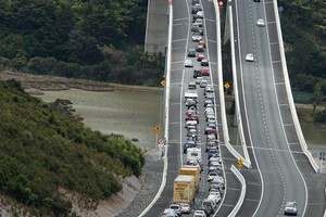 Holiday commuters queue in the northbound lanes of the Northern Gateway Toll Road. Photo / NZ Herald