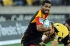 Chiefs Lelia Masaga slips a Hurricanes tackle. Photo / NZPA