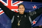 New Zealand's Valerie Vili stands proud after winning Gold in the Womens Shot Put. Photo / NZPA
