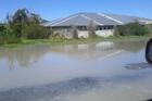 Liquefaction has been reported in the eastern suburbs and 15,000 people there are without electricity. Photo / Laura Campbell