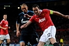 John O'Shea of Manchester United competes with Edu of Schalke. Photo / Getty Images