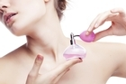Perfume will last twice as long if it is sprayed on when you are fresh from the shower. Photo / Thinkstock