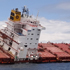 The Smit Borneo removes containers from the deck of the Rena. Photo / Maritime New Zealand