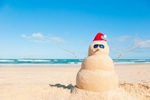 A sand snowman..something more New Zealanders would probably prefer to make at Christmas time, according to a new survey. Photo / Thinkstock