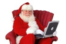 Santa took some time out of his busy pre-Christmas schedule to talk to the Herald Online - which he's seen checking here. Photo / Thinkstock