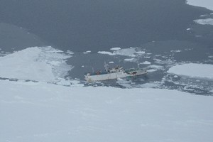 Russian fishing vessel Sparta is seen listing near an ice floe in the Ross Sea after taking on water. / USAF