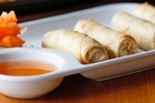 Spring roll starter and sizzling beef at tusk. Photo / Richard Robinson