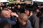 Clashes erupted on Monday between police and several hundred ultra-Orthodox Jews from a town near Jerusalem who are campaigning for men and women to be segregated.