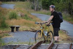 Mathew Dearnaly walks over a disused rail bridge on the Pou Herenga Tai. Photo / Greg Bowker