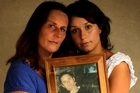 Lorraine Bennett and her daughter Chelsea hold a picture of Shane. Photo / Alan Gibson