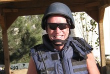 Chris Carter  wears the body armour essential to lide in Afghanistan. Photo / Supplied