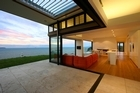 Korora sits on top of a hill on Waiheke Island and features expansive views overlooking the water. Photo / Supplied