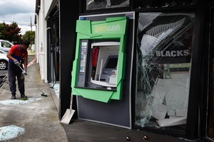 One arrest was made after this ram-raid on an ATM in Manurewa, but police say at least three other suspects remain at large. Photo / Sarah Ivey