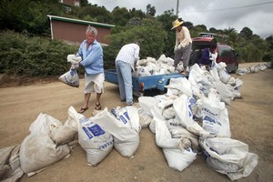 These householders in Glenduan, northeast of Nelson, aren't taking any chances, stockpiling sandbags  in case  their area is hit by floods.  Photo / Tim Cuff