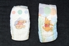 Left, from Parallel Imported (Huggies Super Dry, 4yrs plus and from 9-16kg). Right, bought in NZ, regular Huggies 'Walker' Nappy (from 13-18kg). Photo / Janna Dixon