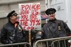Occupy Wall Street protests raced around the world as many people identified with the call to make the 1per cent more accountable. Photo / AP