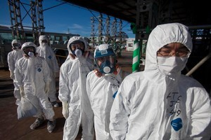 The power of the tsunami transformed into an invisible threat when it caused nuclear meltdown at Fukushima. Photo / AP