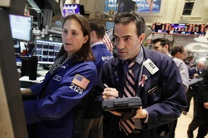 A surfeit of corporate news kept traders busy. Photo / AP