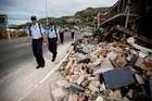 Australian police inspect damage in Lyttelton following the earthquake of February 22. Photo / Dean Purcell