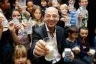 Fonterra chief executive Theo Spierings drinks milk with the kids. Photo / Sarah Ivey