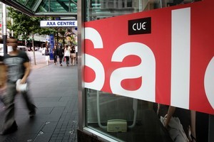 Christmas sales and Boxing Day sale signs are outside shops along Queen Street in central Auckland city.   Photo / Sarah Ivey