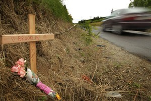 A cross at the site where the two girls were killed. Photo / Alan Gibson