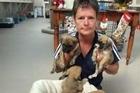 SPCA inspector Helen Saunders, of Alexandra, with a litter of nine puppies found dumped beside Lake Dunstan on December 23. Photo / Lynda Van Kempen.