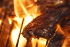 Big flames may create a spectacle but the remnants of burnt steaks and sausages may also leave a bad taste in your mouth. Photo / Thinkstock