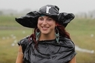 Sari Blum, 25, from Denver, Colorado, is prepared for the wet weather at Coro Gold. Photo / Christine Cornege