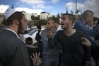 Secular Israelis (R) argue with ultra Orthodox Jewish protesters in the central town of Beit Shemesh, near Jerusalem, on December 26, 2011. Photo / AFP