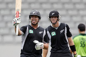 Jesse Ryder of the Black Caps celebrates his half century while teammate Matin Guptill looks on. Photo / Getty Images