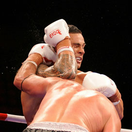 Scott Lewis of Australia connects a punch with Sonny Bill Williams of New Zealand. Photo / Getty Images
