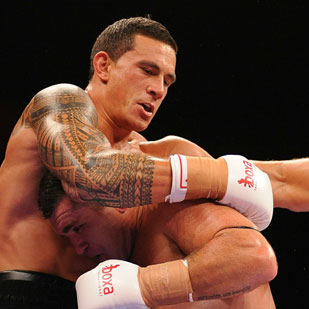 Sonny Bill Williams of New Zealand and Scott Lewis of Australia. Photo / Getty Images