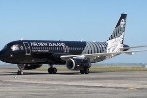 Air New Zealand's new All Black A320 aircraft arrives at Auckland Domestic Airport with All Black captain Richie McCaw.Photo / Natalie Slade
