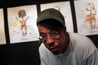 Graffiti artist Eric Orr in front of his art being displayed at Rebel Yell Gallery Auckland. Photo / Doug Sherring