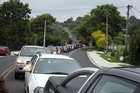 Traffic is backed up on Lake Road which feeds directly to Onewa Road. Photo / Janna Dixon