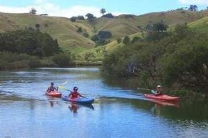 The Puhoi river valley scenery is a pleasant distraction from the tired arms. Photo / Supplied